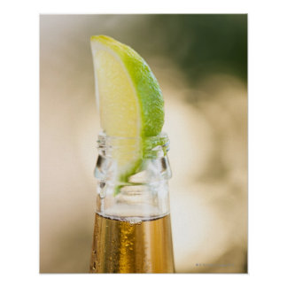 Beer bottle with lime wedge poster