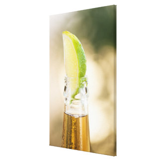 Beer bottle with lime wedge stretched canvas print
