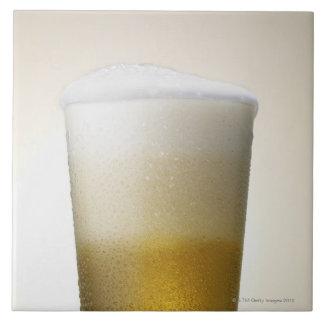 beer with foamy head tile