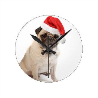 Beige pug with red santa hat on round clock