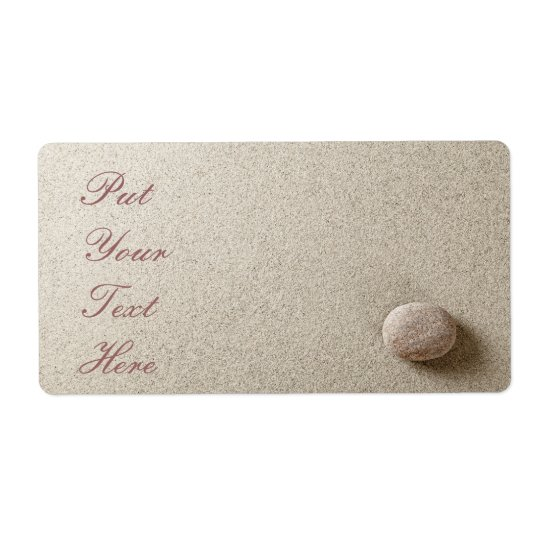 Beige stone on sand background shipping label