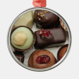 Belgium chocolates round metal christmas ornament
