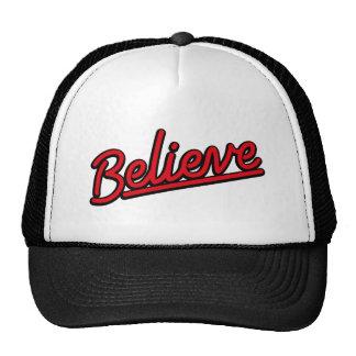 Believe neon sign in red mesh hats