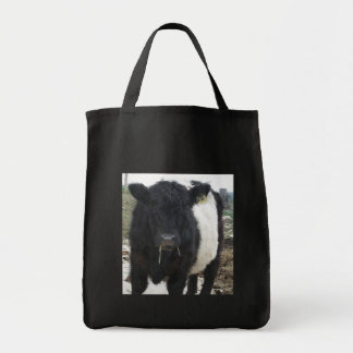 Belted Galloway Cow Eating Hay Tote Bag