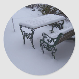 Bench on a snowy day classic round sticker