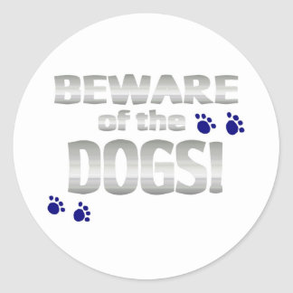 Beware of the dogs! with blue paw prints round sticker