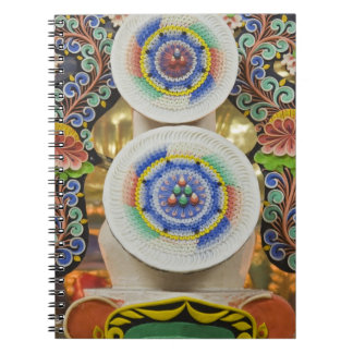 Bhutan. Ceremonial cakes made by monks adorn the Notebook