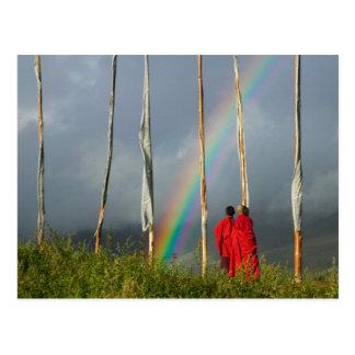 Bhutan, Gangtey village, Rainbow over two monks Postcard