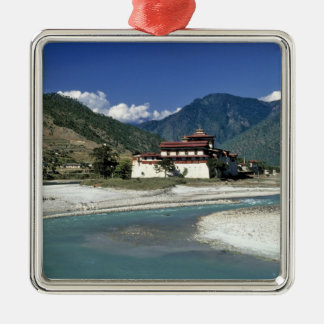 Bhutan, Punaka. The Mo Chhu River flows past Silver-Colored Square Decoration