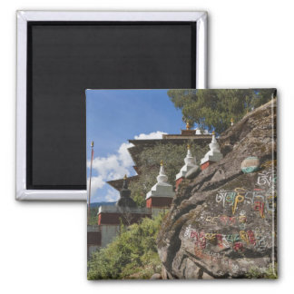 Bhutanese writing on rocks and Nepalese chortens Square Magnet