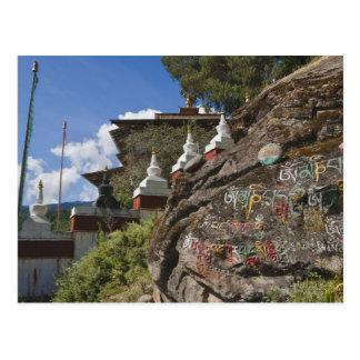 Bhutanese writing on rocks and Nepalese chortens Postcard