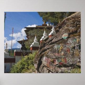 Bhutanese writing on rocks and Nepalese chortens Poster