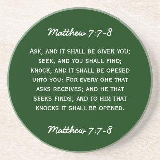 Bible passage Matthew 7:7-8 in white text. Sandstone Coaster