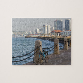 Bicycle at waterfront with Yantai city skyline, Jigsaw Puzzle