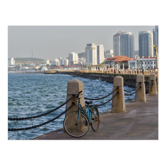 Bicycle at waterfront with Yantai city skyline, Postcard