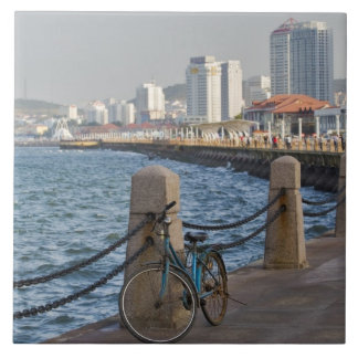 Bicycle at waterfront with Yantai city skyline, Tile