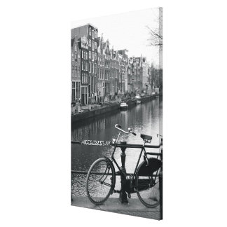 Bicycle by Canal Stretched Canvas Print
