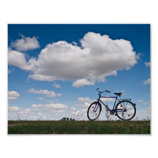Bicycle with clouds and blue sky poster