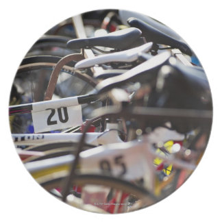 Bicycles on the rack at a triathlon race ready dinner plate