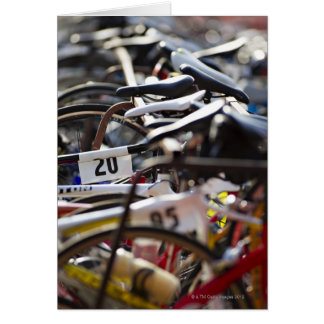 Bicycles on the rack at a triathlon race ready greeting card