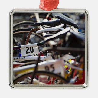 Bicycles on the rack at a triathlon race ready Silver-Colored square decoration