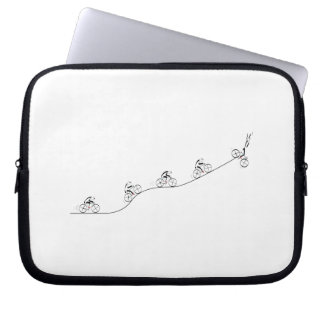 Bicyclist going over the hill laptop sleeves