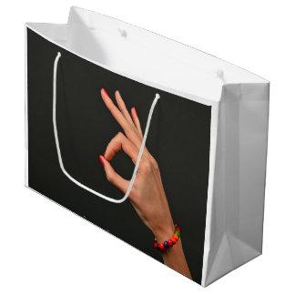 Big bag with woman hand on black