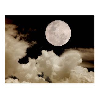 Big moon passing behind clouds postcards