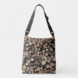 Big pile of cut logs stacked on top of each other crossbody bag