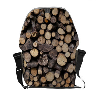 Big pile of sawn logs stacked on top of each other messenger bags