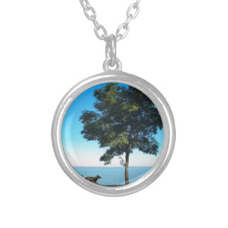 Big tree and the walking path along the lake shore round pendant necklace