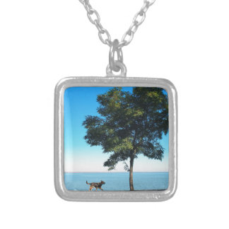 Big tree and the walking path along the lake shore square pendant necklace