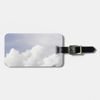 Big white clouds over the mountains tag for bags