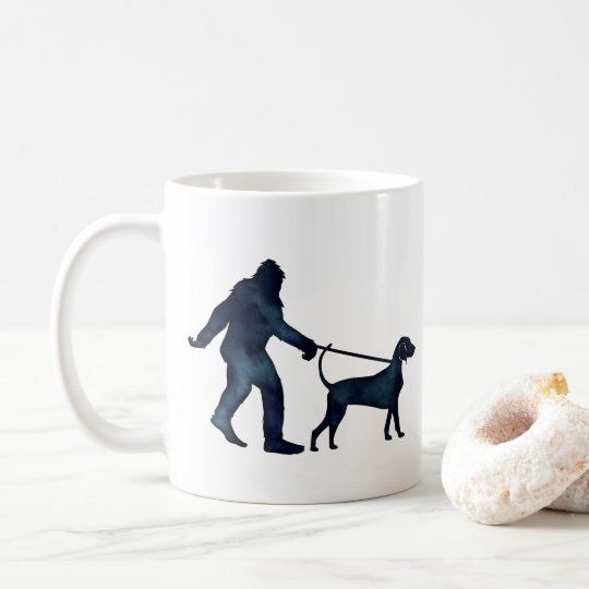 Bigfoot Walking a Bluetick Coonhound on a Leash Coffee Mug