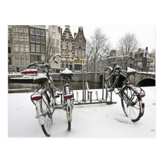 Bikes in snowy Amsterdam in the Netherlands Postcard