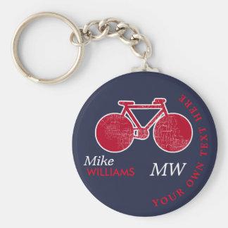 biking, red bike on blue key-chain with name key ring