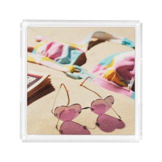 Bikini Top And Heart Shape Sunglasses On Beach