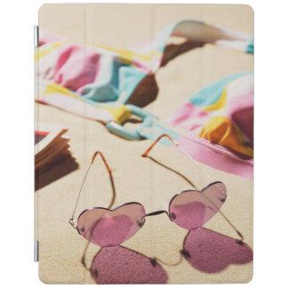 Bikini Top And Heart Shape Sunglasses On Beach iPad Cover
