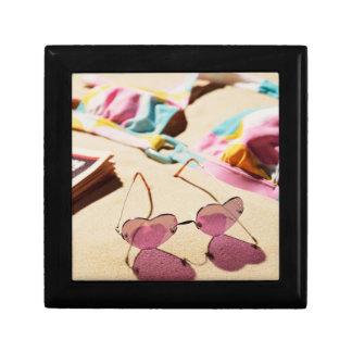 Bikini Top And Heart Shape Sunglasses On Beach Small Square Gift Box