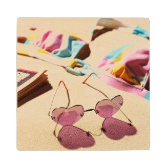 Bikini Top And Heart Shape Sunglasses On Beach Wood Coaster