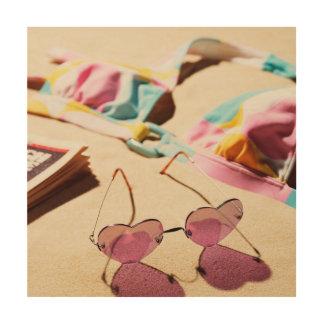 Bikini Top And Heart Shape Sunglasses On Beach Wood Print