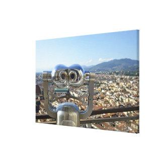 Binoculars overlooking Florence cityscape, top Canvas Print