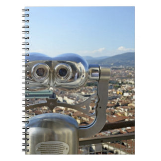 Binoculars overlooking Florence cityscape, top Notebooks
