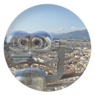 Binoculars overlooking Florence cityscape, top Plate