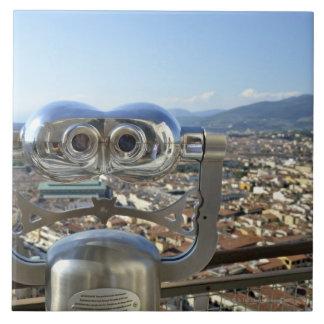 Binoculars overlooking Florence cityscape, top Tile