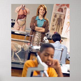 Biology teacher standing in class poster