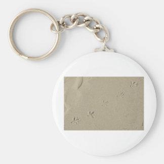 Bird footprints in sand keychain