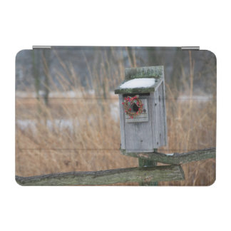 Bird, nest box with holiday wreath in winter iPad mini cover
