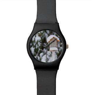 Birdhouse near pine tree in winter wrist watches