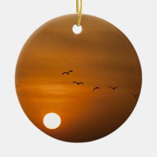 Birds flying in sunset round ceramic decoration